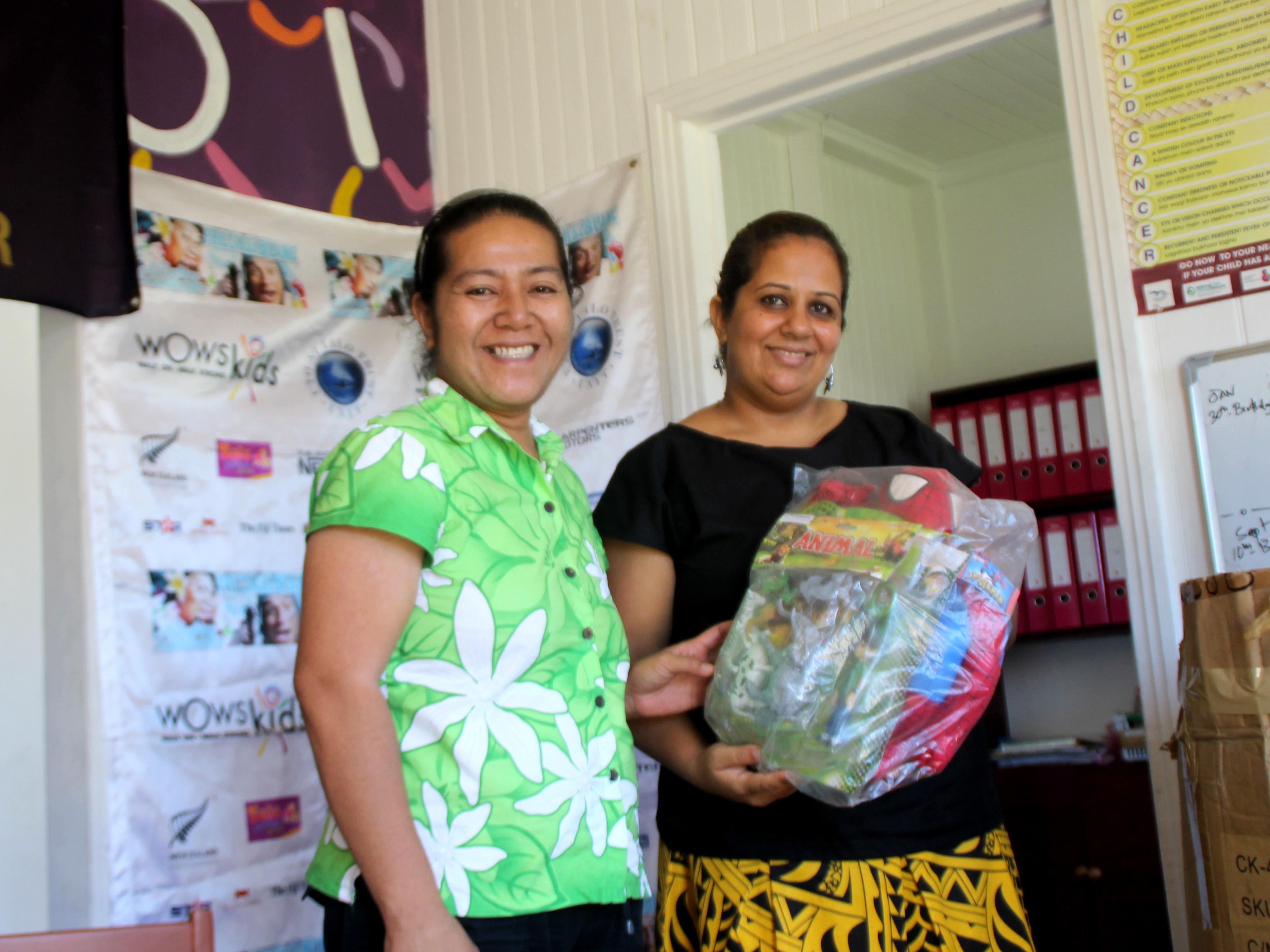SC Fiji CEO, Iris Low-McKenzie presents toy donations to WOWs Kids (Fiji) Team Leader Fanny Fitali